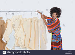 Designer Sewing Patterns Magnificent African American Female Designer With Sewing Patterns On Clothes