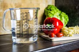 Kitchen counter with food Thanksgiving 750ml Water In Measuring Cup On Kitchen Counter With Food Fotosearch 750ml Water In Measuring Cup On Kitchen Counter With Food Stock