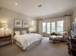bedroom lighting should be warm soft and soothing which you can use a combination of overhead lighting with wall and reading light will facilitate the bedroom overhead lighting