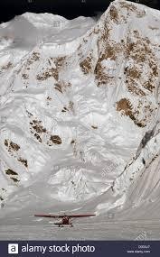 Light Hunter Photography Ski Equipped Light Aircraft Rests Below Alaskas Mount