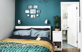 ikea furniture for small spaces. a bedroom with dark green wall and colourful bedding ikea furniture for small spaces i