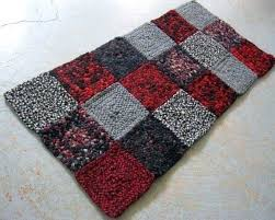 ready to ship wool rectangular braided rug made of squares vintage hunting jackets in crimson red