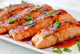 broiled salmon fillets with a spicy sauce
