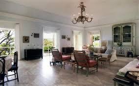 chandelier lit living wood floors antique style