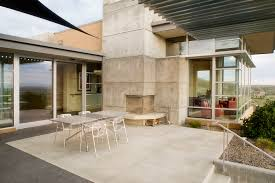 corner outdoor fireplace patio modern with concrete fireplace surround concrete image by glancey rockwell associates