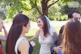 candid photo of the bride with wedding guests at the hildene in manchester vt