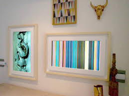 behind the design digital frames on pictures into wall art with digital picture frames have grown up into wall art hgtv smart home