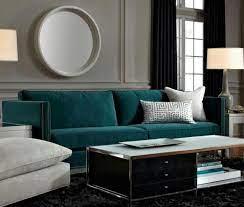 deep teal sofa is a gem against grey