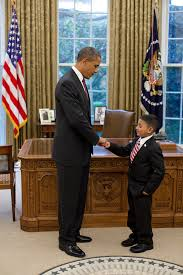 president barack obama fist bumps make a wish child juan blanco in the barack obama enters oval