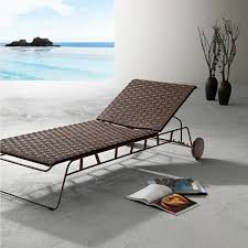 stylish sun bed in steel frame woven with sunveawe in the white version or pvc straps in the coffee version designpass co the world s finest design