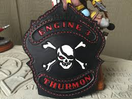 skull and cross bones fire helmet shield