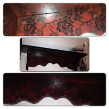 Black shelf with red lace decoration. super easy. just lay lace