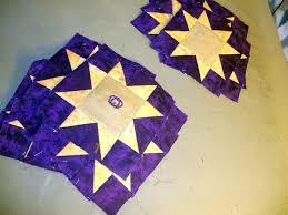 Katie's Quilts and Crafts: New Crown Royal Quilt & For the borders stars I used the gold/leather crown royal quilt. and purple  background. Adamdwight.com
