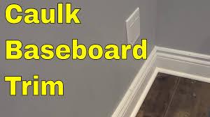 how to caulk baseboard trim tutorial for hiding gaps