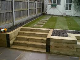 garden design using sleepers. bench steps raised bed made of railway sleepers fairly plain layout but useful for ideas might need antislip coating wetweather garden design using