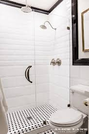black and white walk in shower with glossy white beveled tiles