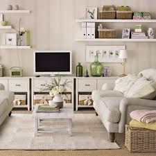 Create a media-friendly arrangement in a family living room. Choose low  units that won't overwhelm the room and keep the wall space above feeling  open by ...