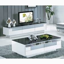 modern and stylish white and black tempered glass coffee table with drawers for the storage