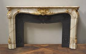 very beautiful antique fireplaces are sometimes provided with their original cast iron insert if so they are often decorated with elegant foliages