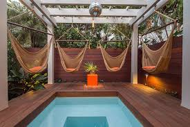 Outdoors Relaxing And Stylish Tropical Style Pool Deck And Enchanting Backyard Paradise Landscaping Ideas