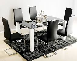 black glass top dining table for 6 with white legs also modern armless dining chairs on black fur rug
