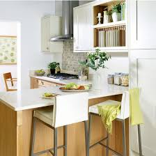 fresh kitchen designs. small kitchen with cream cabinetry, worktops, integrated breakfast bar and leather stools fresh designs c