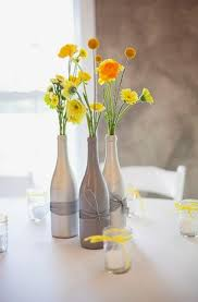 simple beautiful wine bottle centerpieces with ribbon and bold yellow  flowers