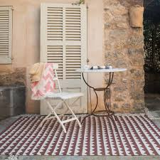 the xl gittan rug in clay from brita sweden is made of soft plastic foil pvc