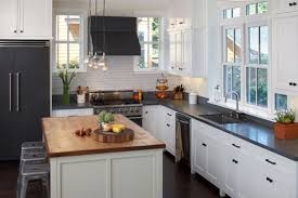 White Wooden Kitchen Cabinet With Black Counter Top Having High