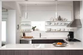 modern kitchen dark wood cabinets pendant lights open shelving white walls concrete countertops