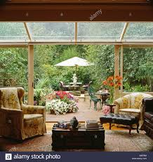 Living Room Extension Armchairs In Glass Conservatory Living Room Extension With Sliding