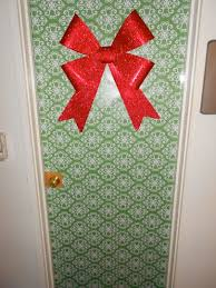 Wrap your dorm room door with holiday paper and slap a fat bow on it.