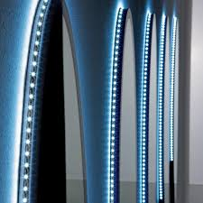 led lighting strips running around the outer rim of these bathroom mirrors simply stick on