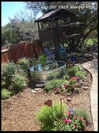 i am so excited for the weather to warm up so i can add some little mosquito fish to the pond and of course for those lilies to start blooming