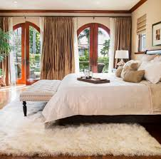 consider this type of white rug for the bedroom to give it a coy and chic