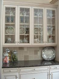 kitchen with well patterned regions and shiny elegant utensils visible through the glass