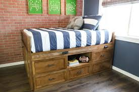 learn how to build this beautiful and functional diy storage bed that also includes a