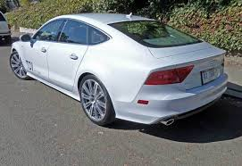 audi a7 2014 coupe. the basic dimensions and design form continue with 2014 audi a7 roofline is low a gracefully arched greenhouse integrated rear doors coupe