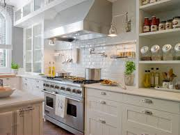 Stunning white & gray kitchen design with warm gray walls paint color, gray  glass subway tiles backsplash, creamy white kitchen cabinets with marble ...