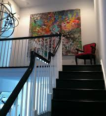designs ideas staircase decor with large abstract wall painting near red armchair create your room