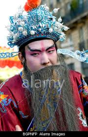 france chinese man in traditional dress beard parading in chinese new
