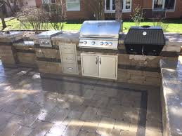 paver patio with outdoor kitchen composite deck naperville