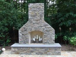 outdoor brick fireplace and pizza oven combo