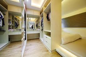 the cove light features create an elegant milieu in this walk in closet