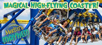 smiling families riding merlin s mayhem coaster