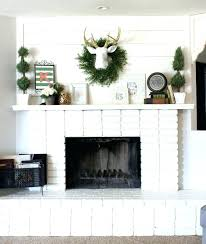 brick fireplace painted white fireplace finishes ideas cowboy decor living room with painted white brick fireplace