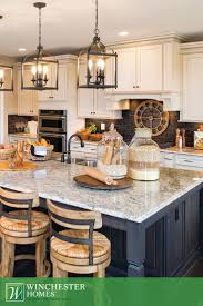 dark island counter which avoids stains from feet and jeans timeless elegance is the key to the kitchen in the raleigh model
