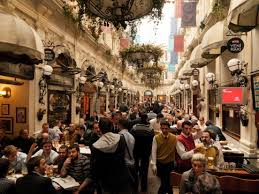 busy restaurant scene. Photo: IStock; Busy Bars And Cafes In The Interior Courtyard Of An Ottoman-era Building Istanbul Restaurant Scene B