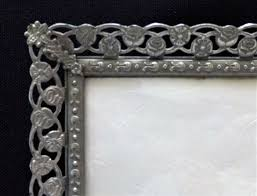 three large silver plated open work filigree photo frames with convex glass