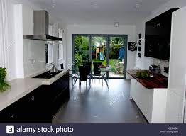 Kitchen And Dining Room Flooring Modern White Kitchen Dining Room With Black Flooring And Glass